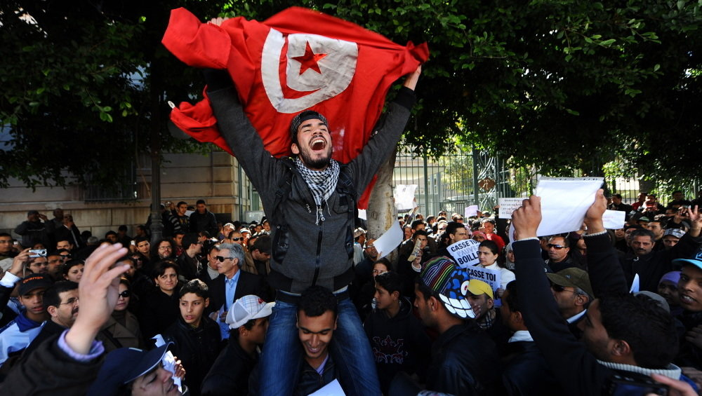 Tunisians protest outside the gates to the French Embassy in Tunisa during the Arab Spring. (Fethi Belaid /AFP/Getty Images)