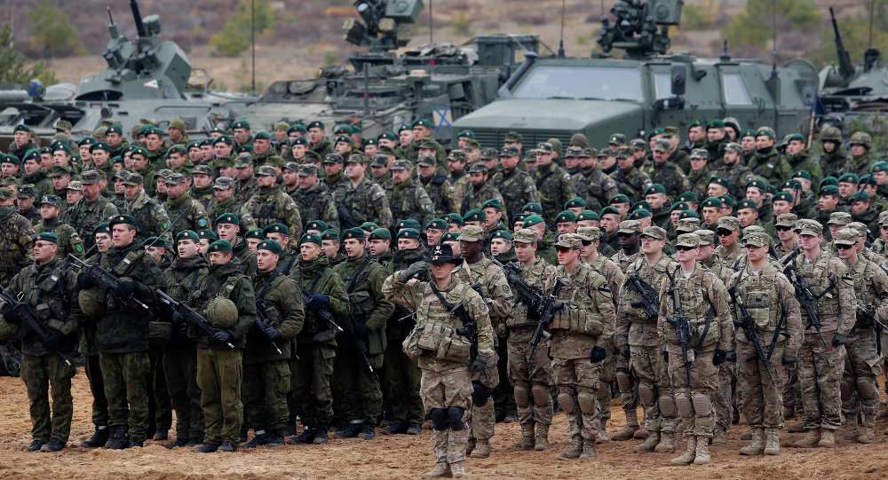 Parade of troops and equipment at the end of a NATO exercise in Lithuania (Mindaugas Kulbis/AP)
