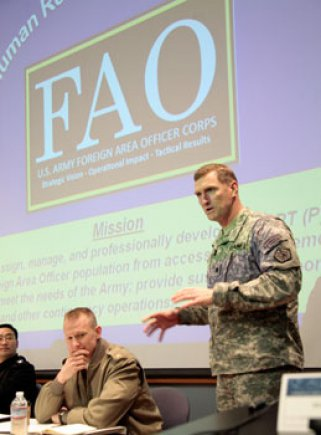 Lieutenant Colonel David Brigham explains the role of the Army Foreign Area Officer during the 4th Annual FAO Conference at the Naval Postgraduate School. (Javier Chagoya/U.S. Navy)