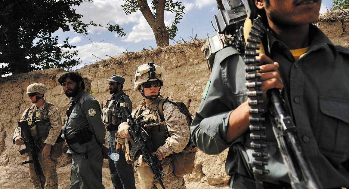 Lance Cpl. April Whitham as one of the Marines patrolling through the village of Soorkano, in Helmand Province. (Lynsey Addario/Getty Images)