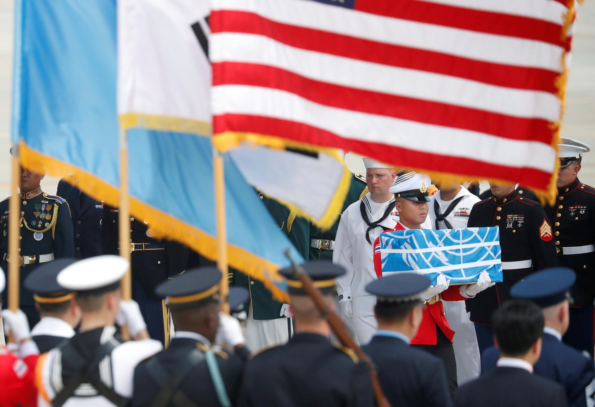 A soldier carries a casket containing the remains of a US soldier killed in the Korean War during a ceremony at Osan Air Base in Pyeongtaek, South Korea, on July 27, 2018. (Reuters)