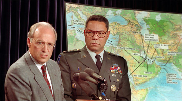 Secretary of Defense Dick Cheney, left, and Colin Powell, the chairman of the Joint Chiefs of Staff, at a Pentagon briefing in August 1990. (Tannen Maury/AP)