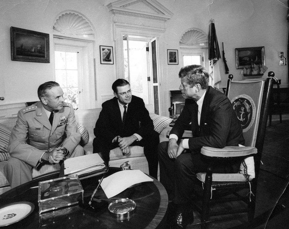 President John F. Kennedy meets with General Maxwell Taylor and Defense Secretary Robert McNamara in the Oval Office of the White House, February 10, 1963. (Getty Images)