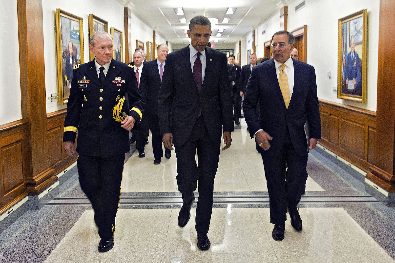 President Barack Obama walks with Defense Secretary Leon E. Panetta and Army General Martin E. Dempsey, Chairman of the Joint Chiefs of Staff, to a press briefing at the Pentagon, Jan. 5, 2012. (DOD Photo/Wikimedia)