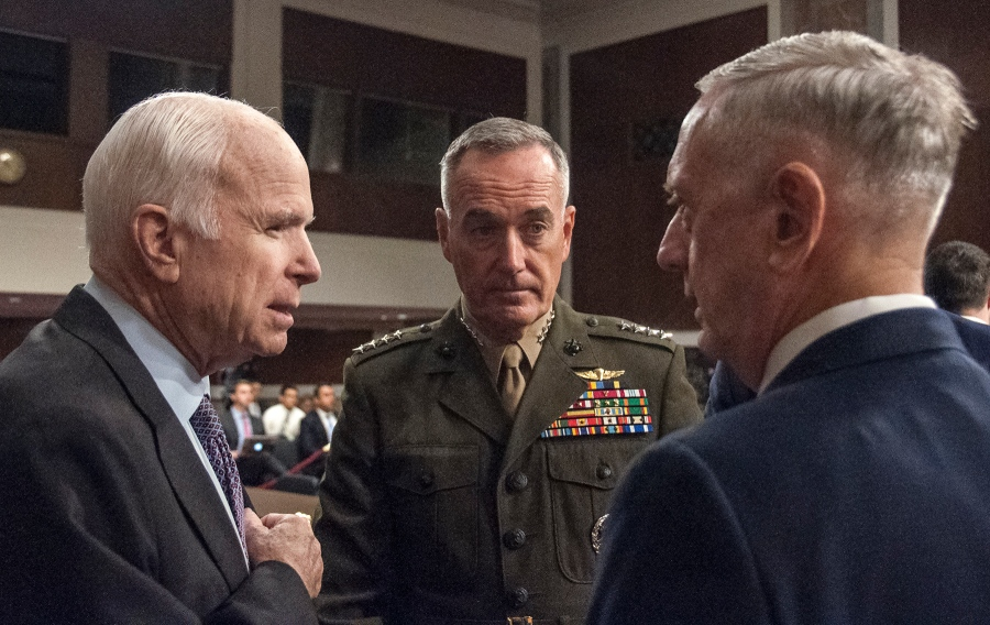 Chairman of the Senate Armed Services Committee, Sen. John McCain, R-Ariz., speaks with Chairman of the Joint Chiefs of Staff General Joseph Dunford and Secretary of Defense James Mattis prior to the start of a hearing Tuesday, Oct. 3, 2017. (Carlos Bongioanni/Stars and Stripes)