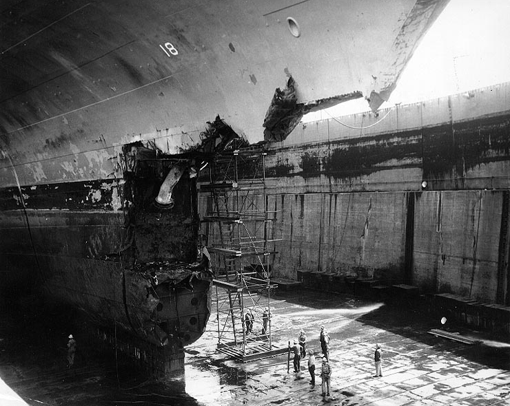 The U.S. Navy aircraft carrier USS Wasp in drydock at Bayonne, New Jersey (USA), showing the damage to the carrier's bow from her 26 April 1952 collision with USS Hobson. (U.S. Navy Photo/Wikimedia)