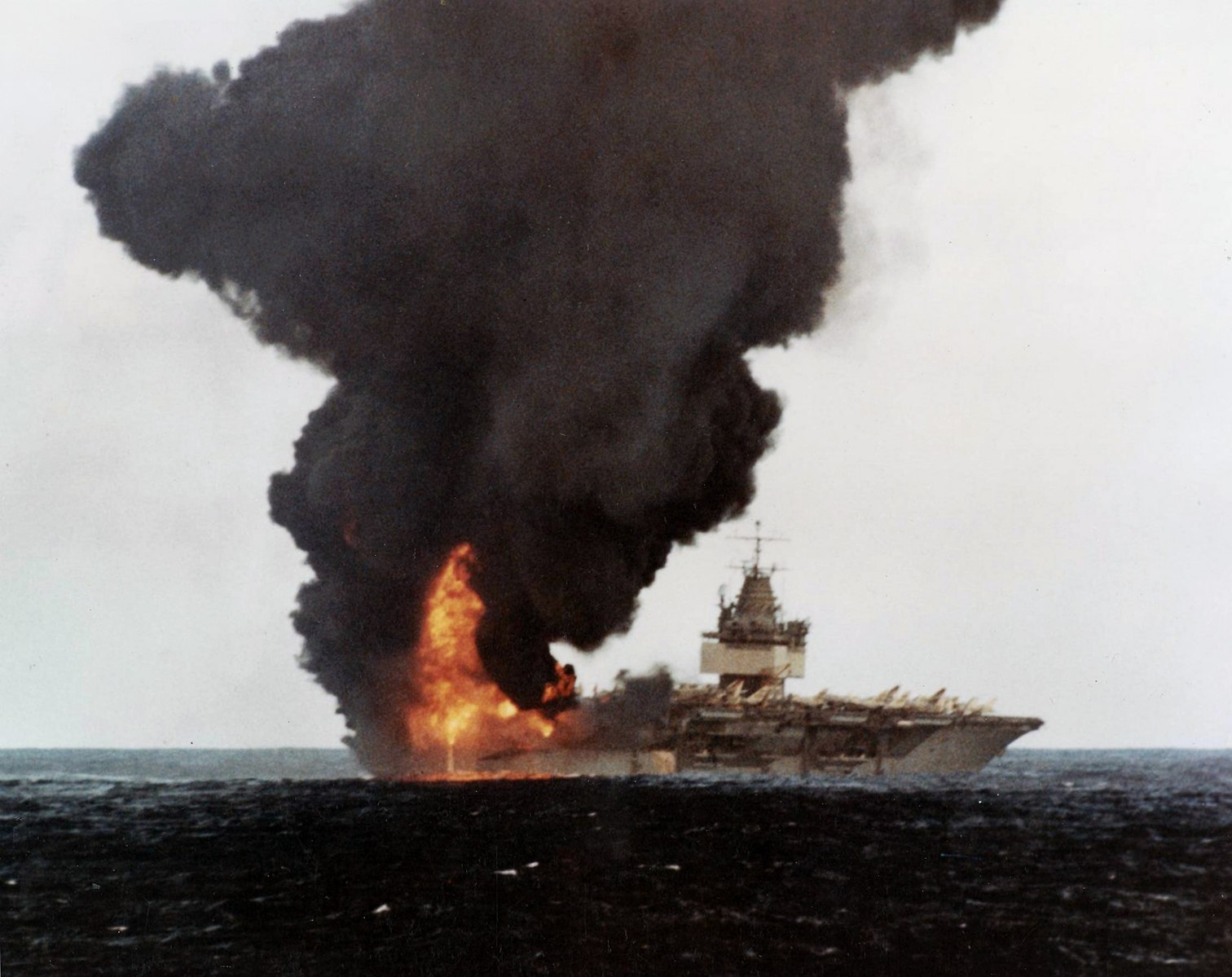 Black smoke rises from the U.S. Navy aircraft carrier USS Enterprise in the aftermath of a fire that occurred while she was underway conducting air operations near Hawaii on 14 January 1969. (U.S. Navy Photo/Wikimedia)
