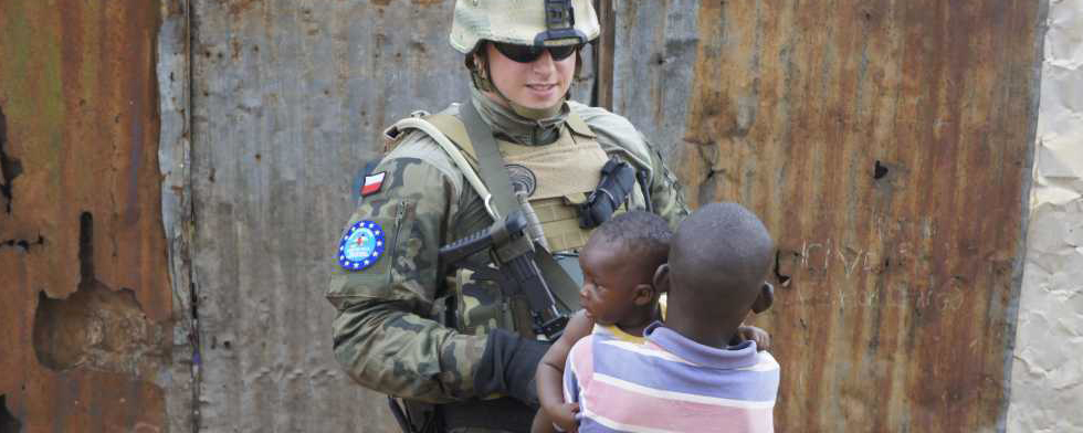 Peacekeeper and children (From the NATO Stability Policing Center or Excellence)