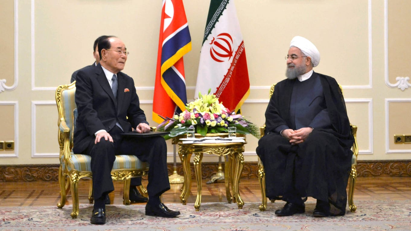 North Korea's Kim Yong Nam and Iran's President Hassan Rouhani. (Reuters)