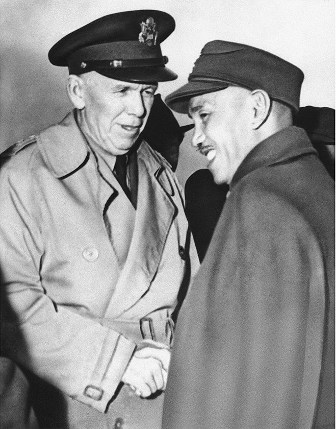 General George C. Marshall is greeted by Generalissimo Chiang Kai-shek in Nanking, China, in 1946. (AP)
