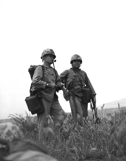 Marine Colonel Lewis B. Puller, who distinguished himself during the Inchon landing, studies the terrain before advancing to another enemy objective. (Marine Corps Photo/Wikimedia)