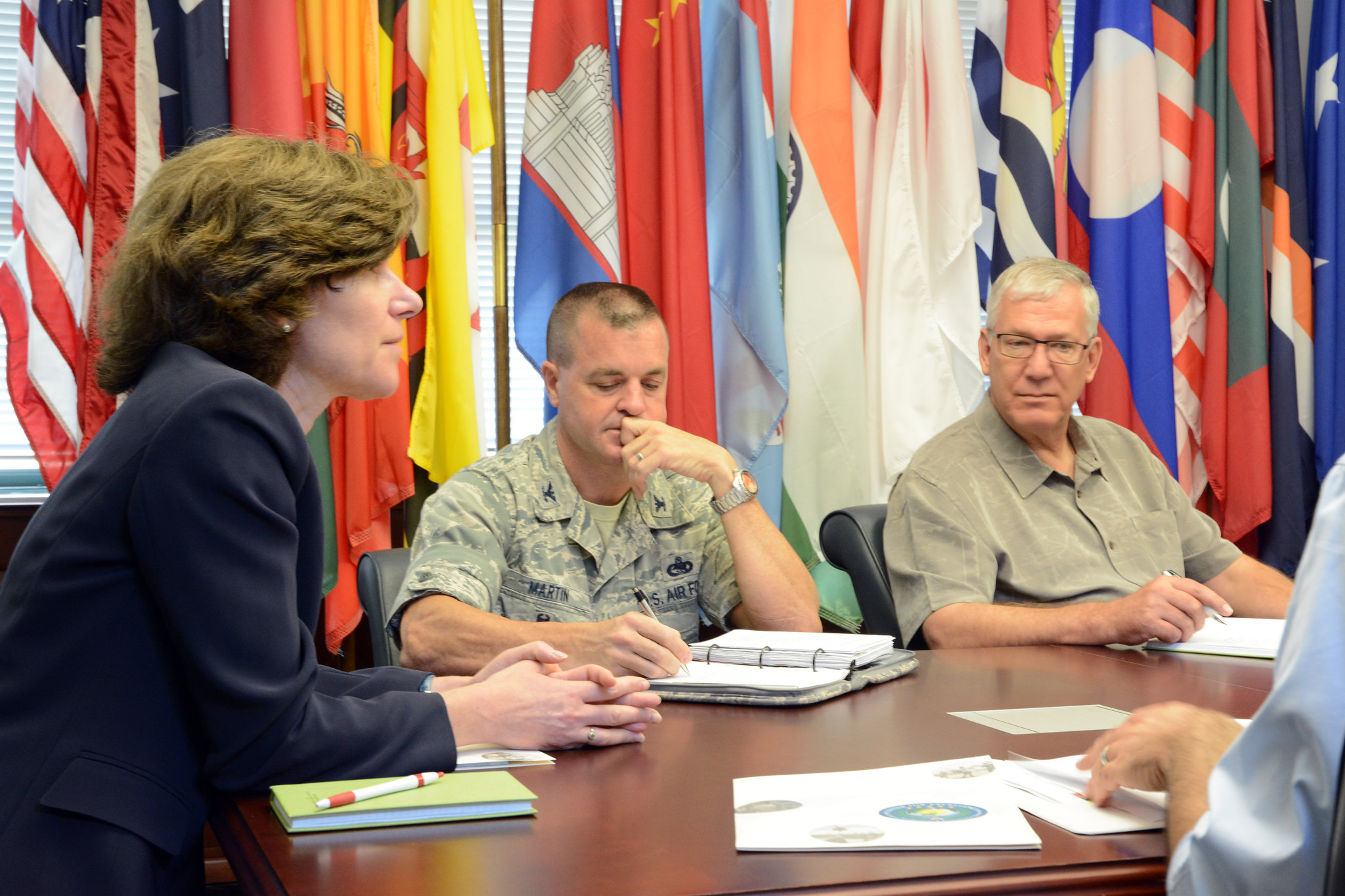 Deputy Assistant Secretary of Defense for Stability and Humanitarian Affairs Anne Witkowsky meets with Center for Excellence in Disaster Management and Humanitarian Assistance Director Col. Joseph Martin and Deputy Director Douglas Wallace at the organization's headquarters in Pearl Harbor, Hawaii July 24, 2015. (US Government Photo)