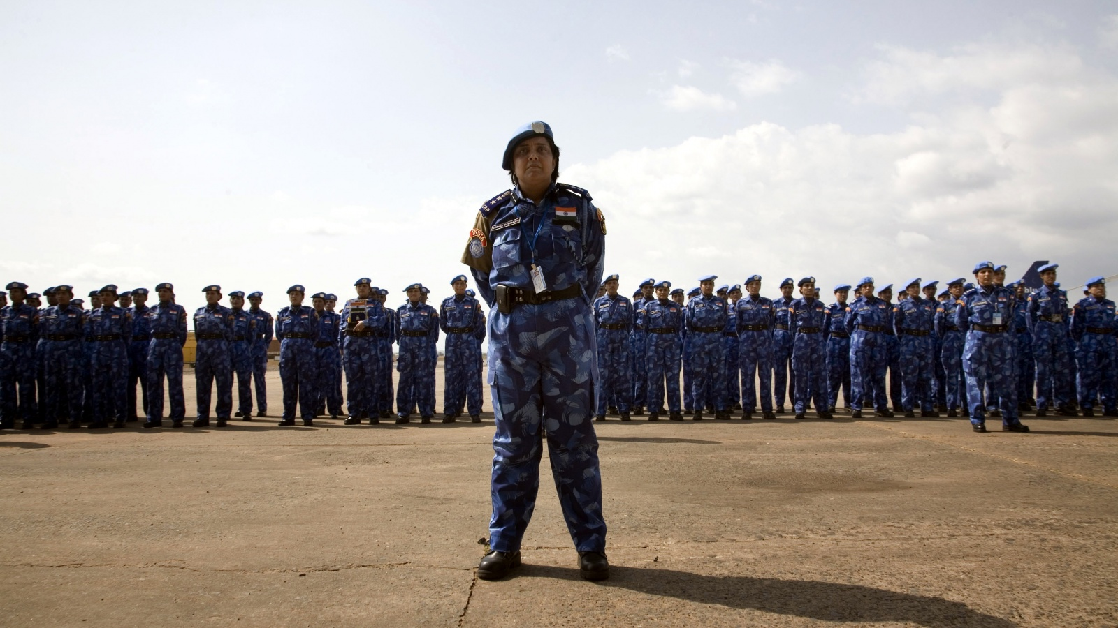 An Indian officer from the first all-female unit of United Nations peacekeepers stands in front of troops as they arrive at Roberts International Airport outside Liberia's capital Monrovia January 30, 2007. (Christopher Herwig/Reuters)