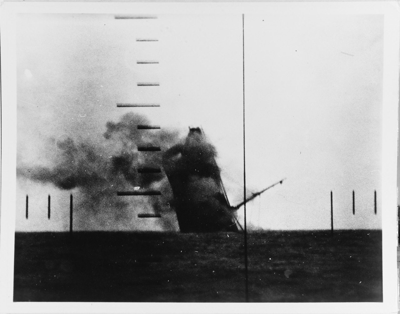 Japanese cargo ship sinking in the Yellow Sea, off China, on 23 March 1943. Periscope photograph, taken from USS Wahoo (SS-238), which had torpedoed her. (U.S. Navy/National Archives)