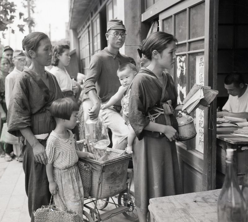 Sept. 21, 1945 in Tokyo, just after the end of the war, the people lined up are waiting for their rations of beans, as rice was not available to them at this time. (Corbis-Bettmann/About Japan)