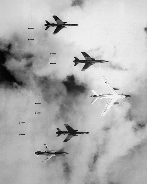F-105 Thunderchiefs radar-bombing at the instruction of a B-66 leader. (Wikimedia)