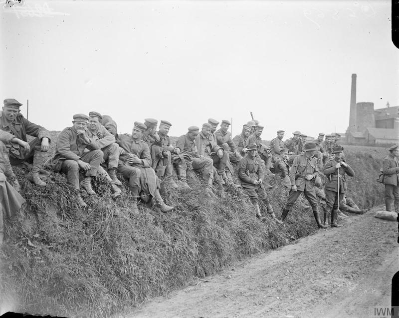 German prisoners being guarded by Australian troops, 23 April 1918. (Imperial War Museums/Wikimedia)