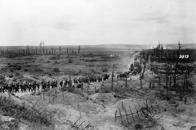 German soldiers advancing past a captured French position, between Loivre and Brimont, Marne department, 1918 (Wikimedia)