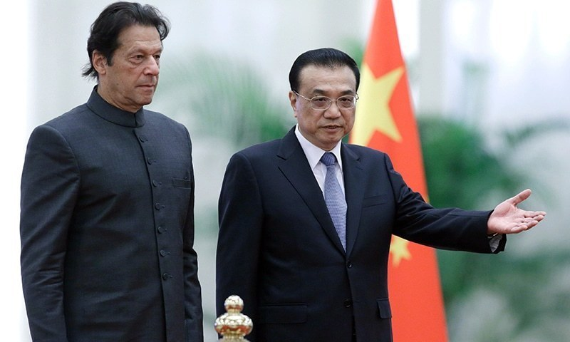 Pakistani Prime Minister Imran Khan and Chinese Premier Li Kequiang at the Great Hall of the People in Beijing in 2018. (AFP)