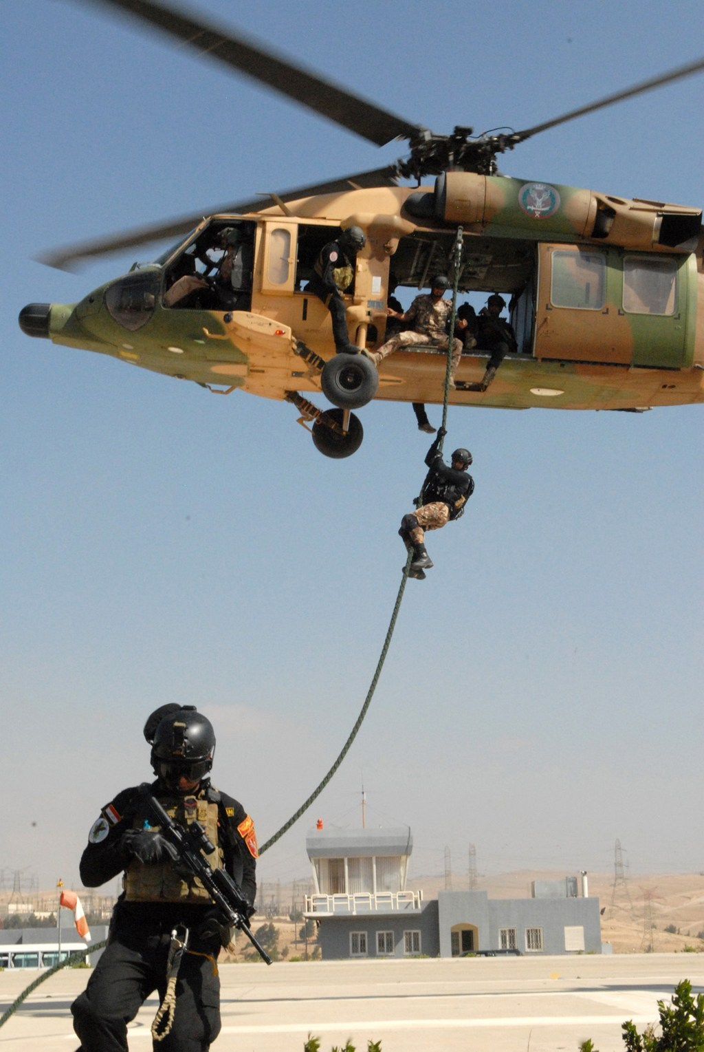 A member of the Jordanian SOF descends from a Jordanian UH-60 Black Hawk helicopter at the Jordanian SOF compound near Zarqa, Jordan, June 13, 2013. Jordan is one of the major Foreign Military Financing recipients. (SSG Scott Griffin/U.S. Army Photo)