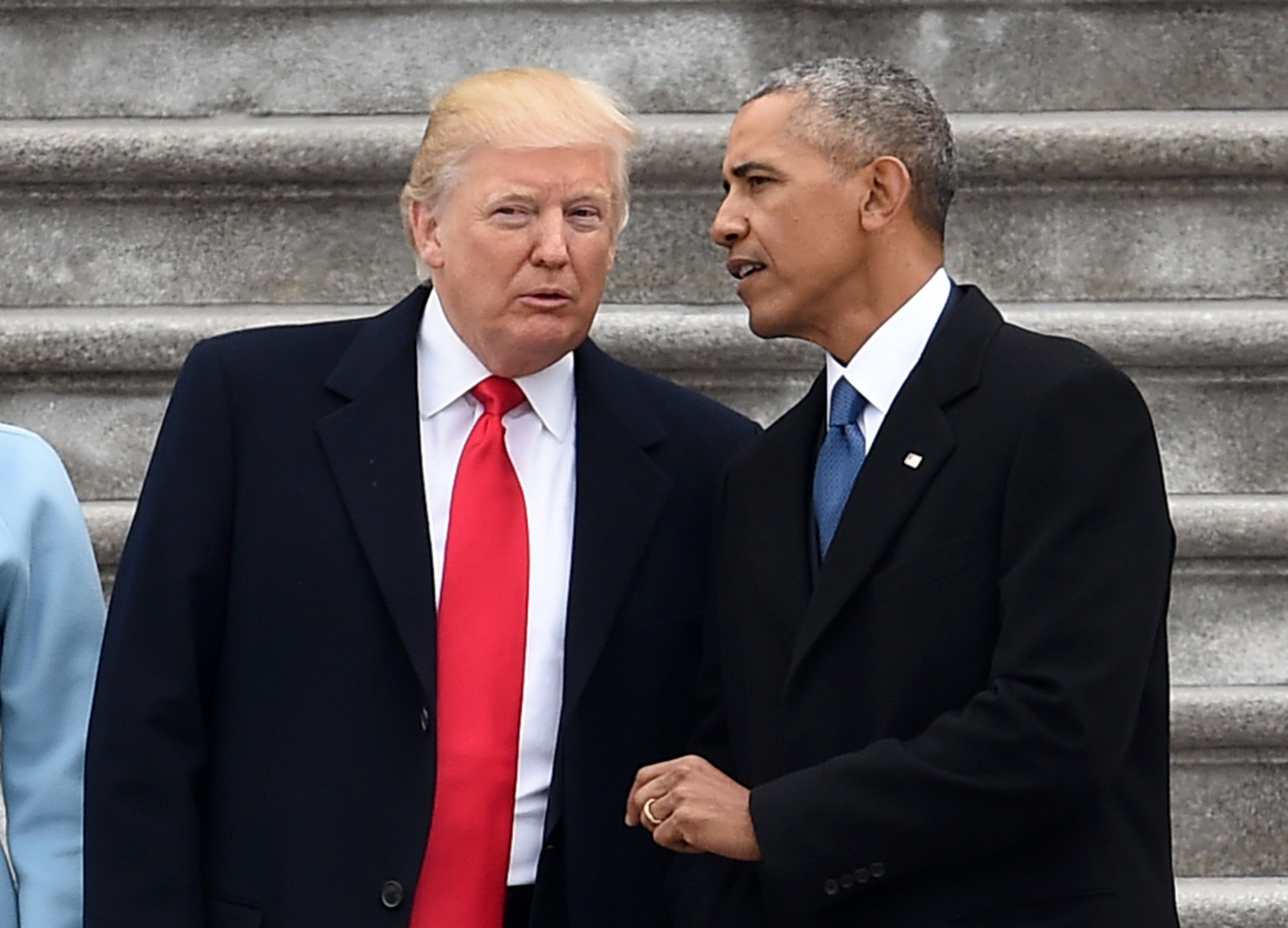 President Donald Trump and former President Barack Obama talk on the East front steps of the US Capitol after inauguration ceremonies on January 20, 2017 in Washington, D.C. (Robyn Beck/AFP)