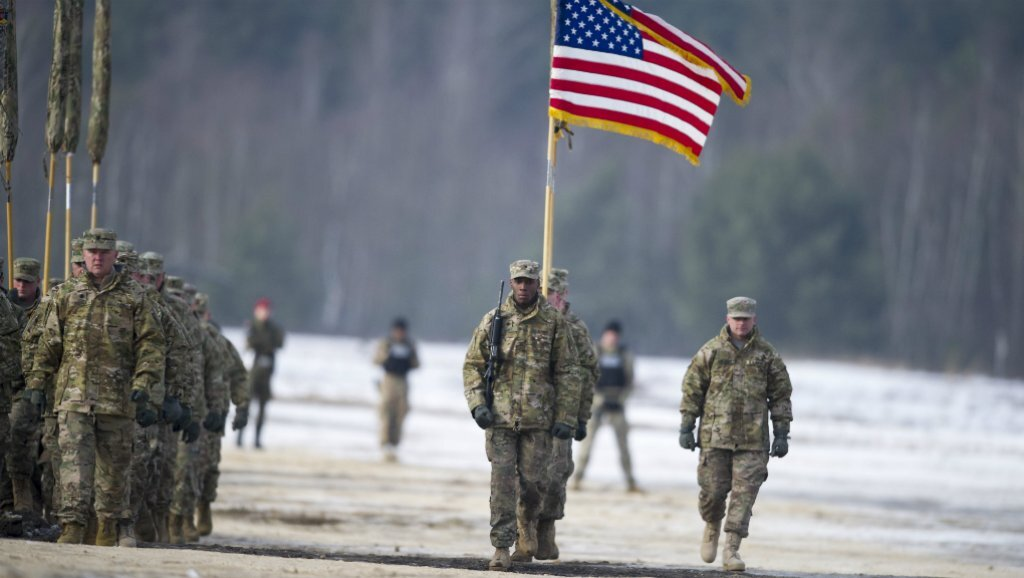 U.S. soldiers march during a bilateral military training exercise of US and Polish Forces in Zagan, Poland on January 30, 2017. (Natalia Dobryszycka/AFP)