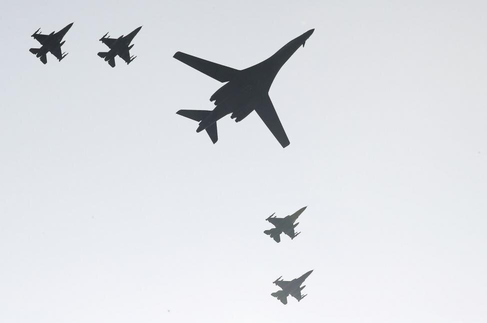 A B-1B Lancer bomber deployed by the U.S. military and four South Korean F-15K fighters fly over Osan Air Base, south of Seoul. (Yonhap/UPI)
