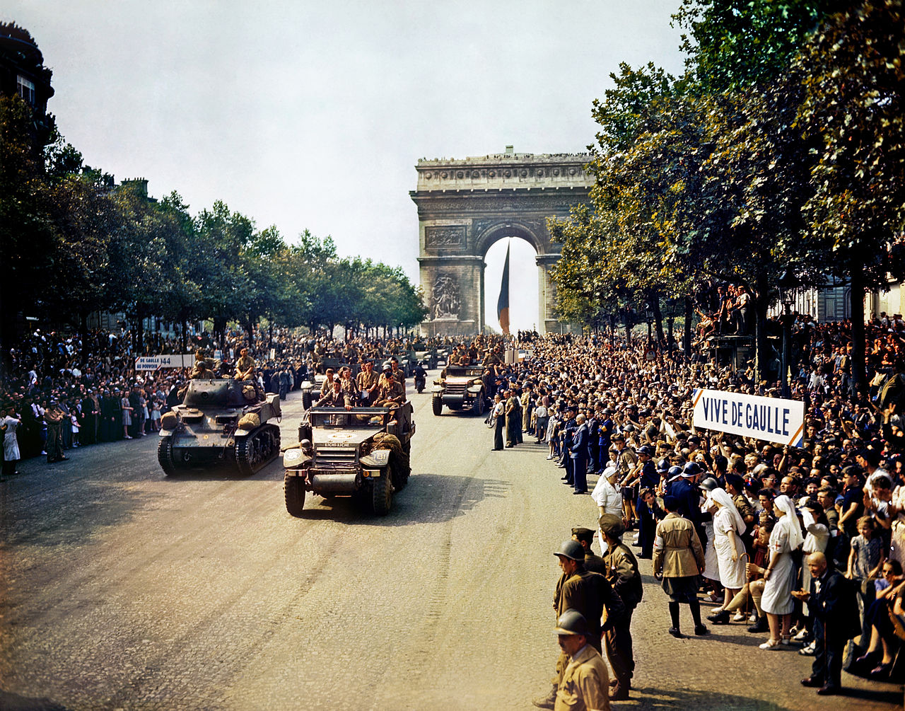 Crowds of French patriots line the Champs Elysees to view Free French tanks and half tracks of General Leclerc's 2nd Armored Division passes through the Arc du Triomphe, after Paris was liberated on August 26, 1944. Among the crowd can be seen banners in support of Charles de Gaulle. (Library of Congress/Wikimedia)
