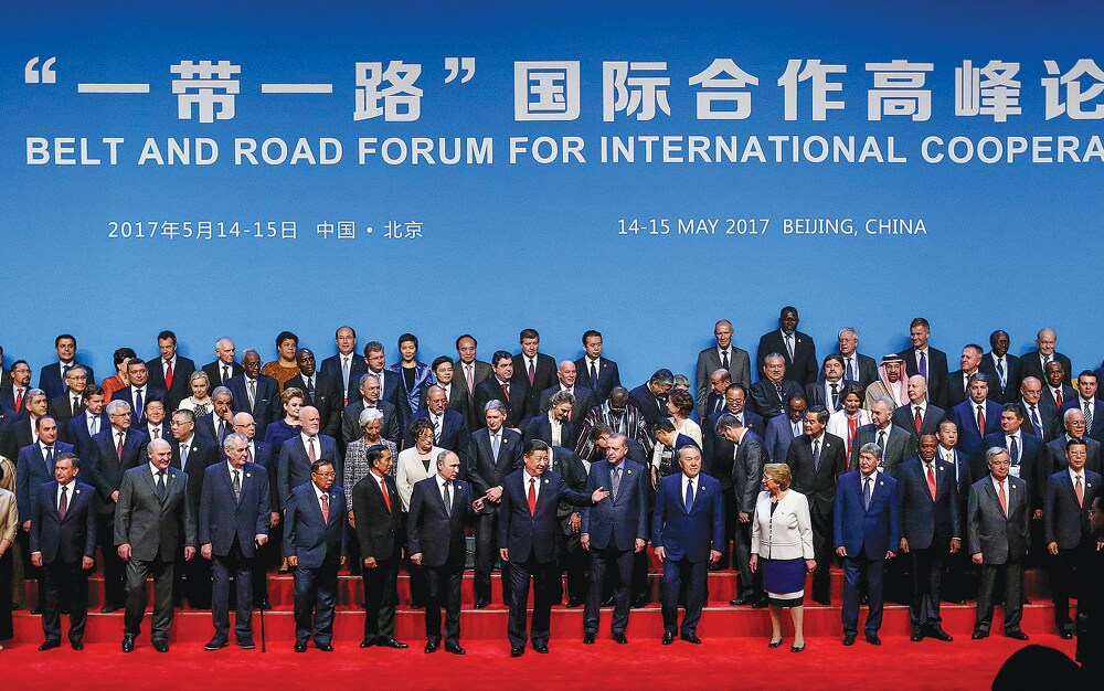 President Xi Jinping with other delegates and guests in a group photo at the opening session of the Belt and Road Forum for International Co-operation in Beijing (Xu JingXing/China Daily)
