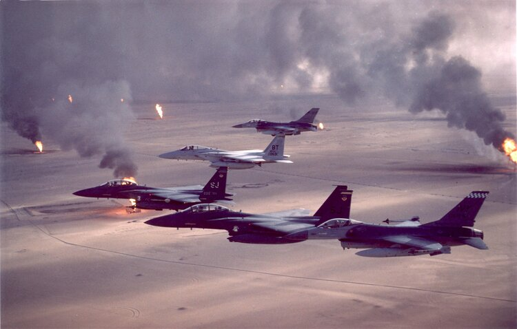 Fighter aircraft fly over burning oil fields in Kuwait during Operation Desert Storm. (U.S. Air Force Photo)