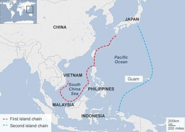 The first island chain extends to Japan and the Philippines and includes the South China Sea; the second island chain encompasses Guam. (BBC)