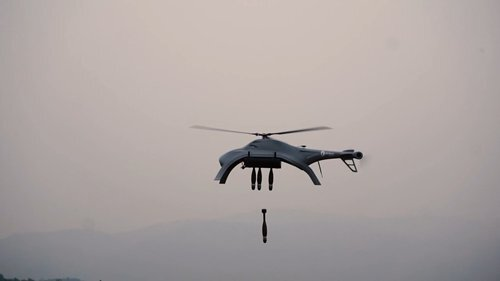 A Blowfish A2 helicopter drone drops bombs while hovering in the air. (Zhuhai Ziyan UAV/Global TImes)