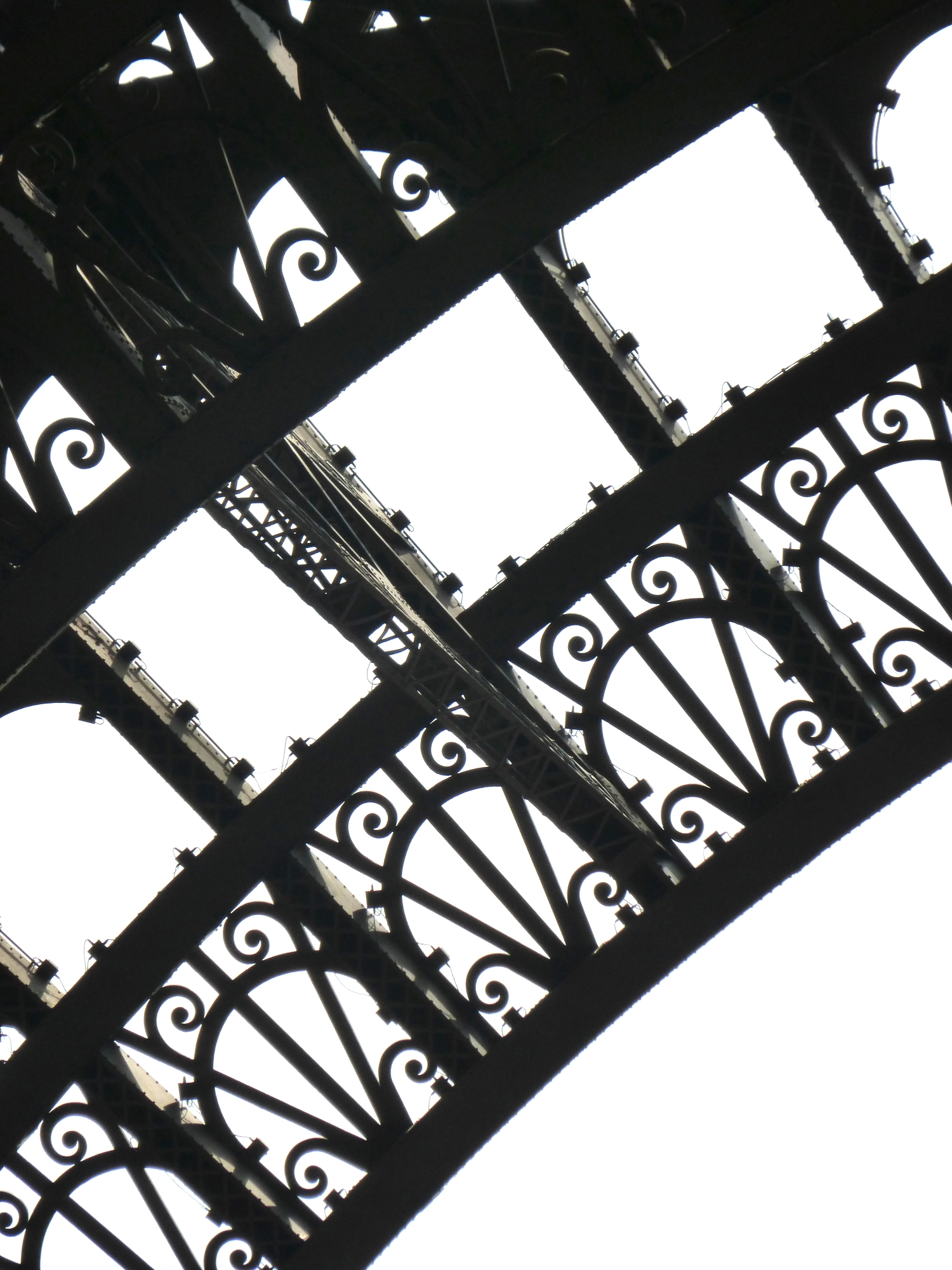 The massive, yet delicate appearing ironwork on the Tour de Eiffel.