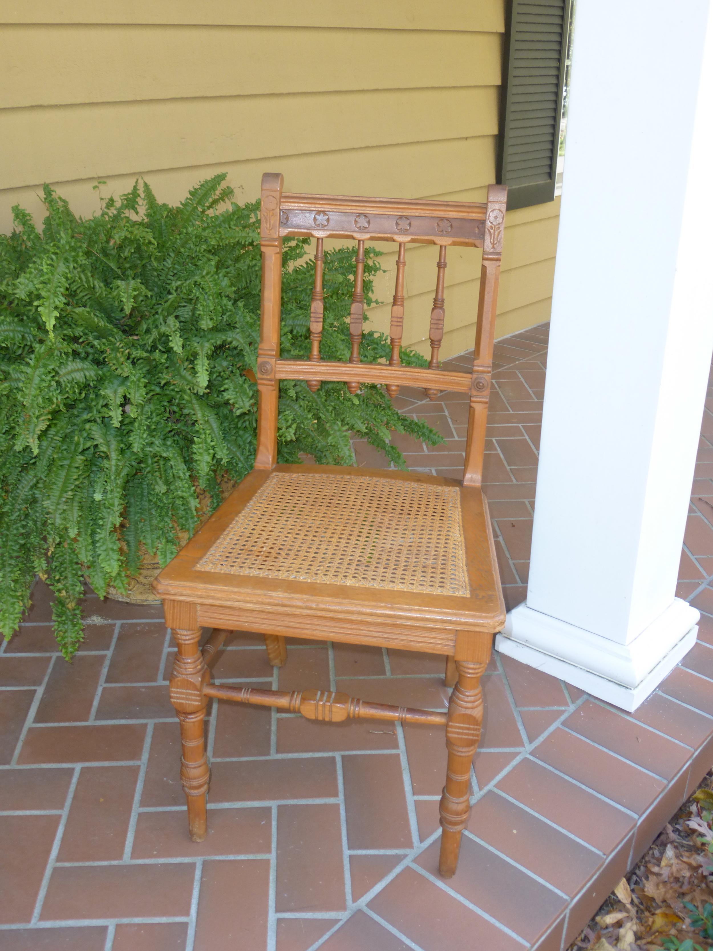 Eastlake cane seat side chair.