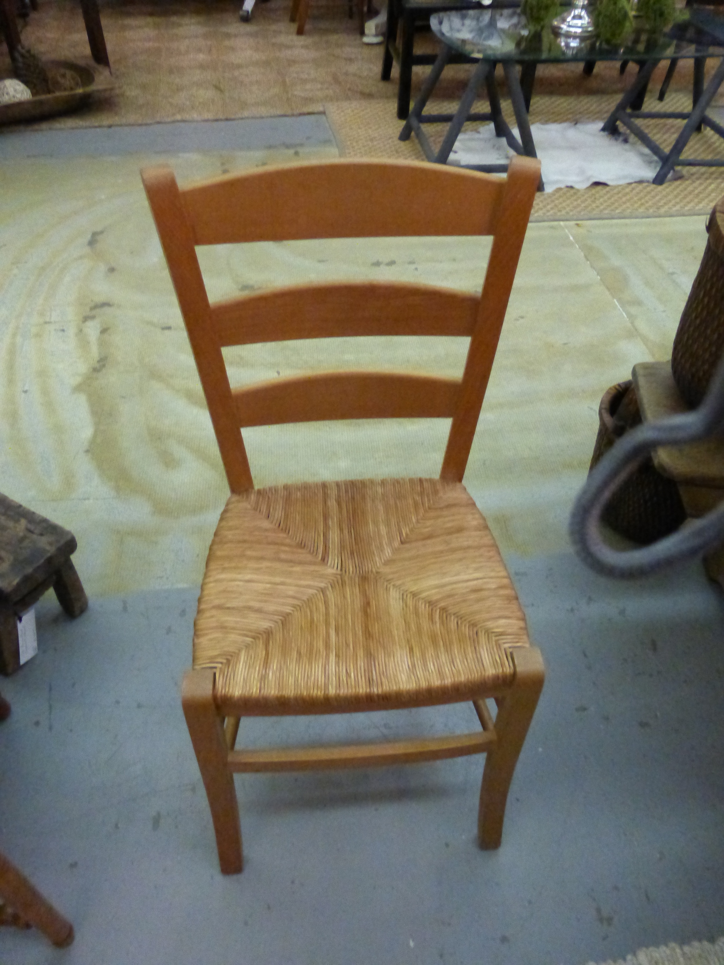 Small rush seat chair is in set of four.