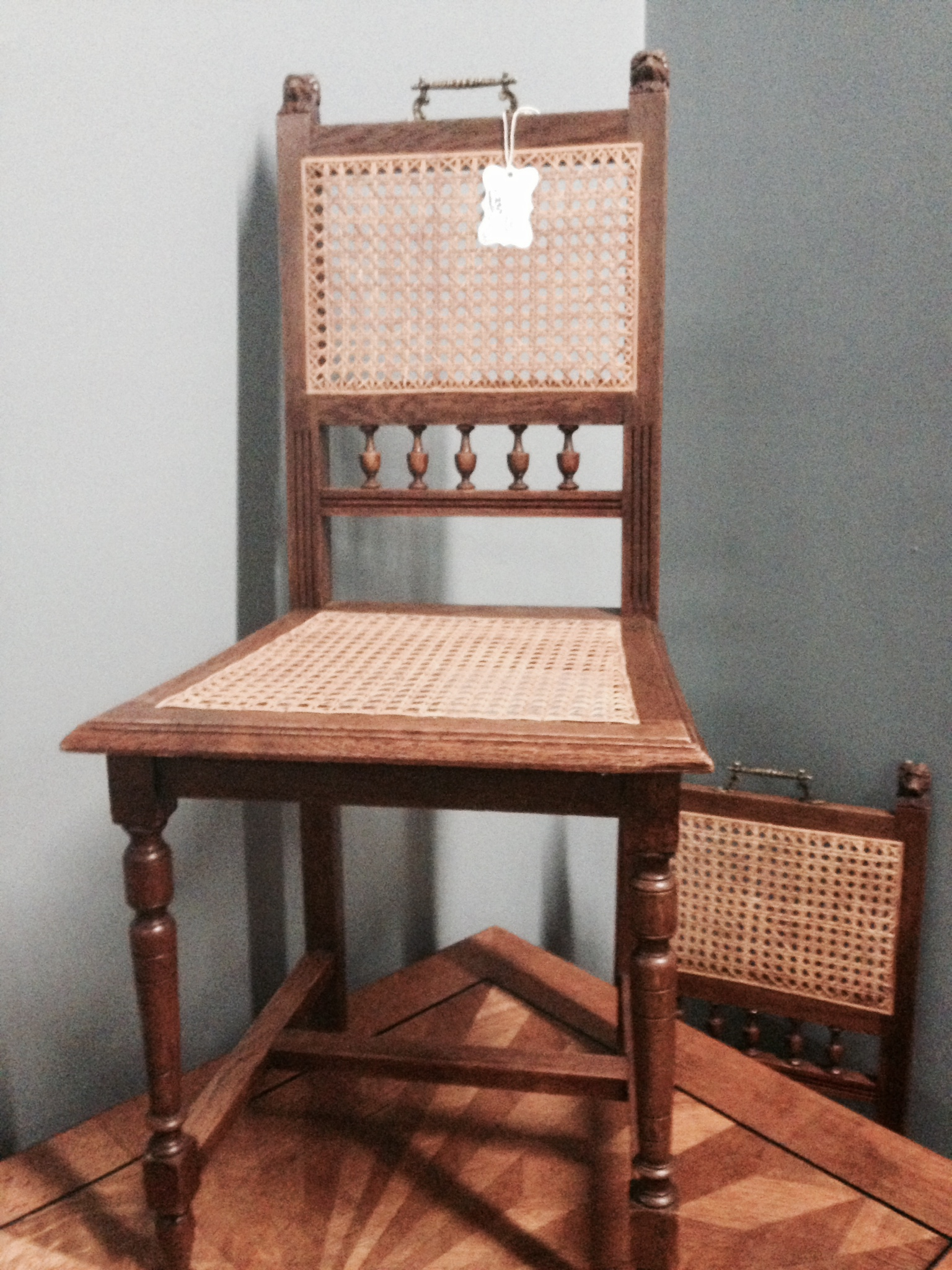 Love the pull handles on this set of four caned French chairs.