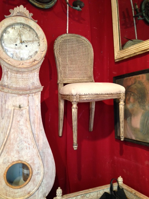 Another of our eight chairs next to this exquisite clock that I also wish I had bought.