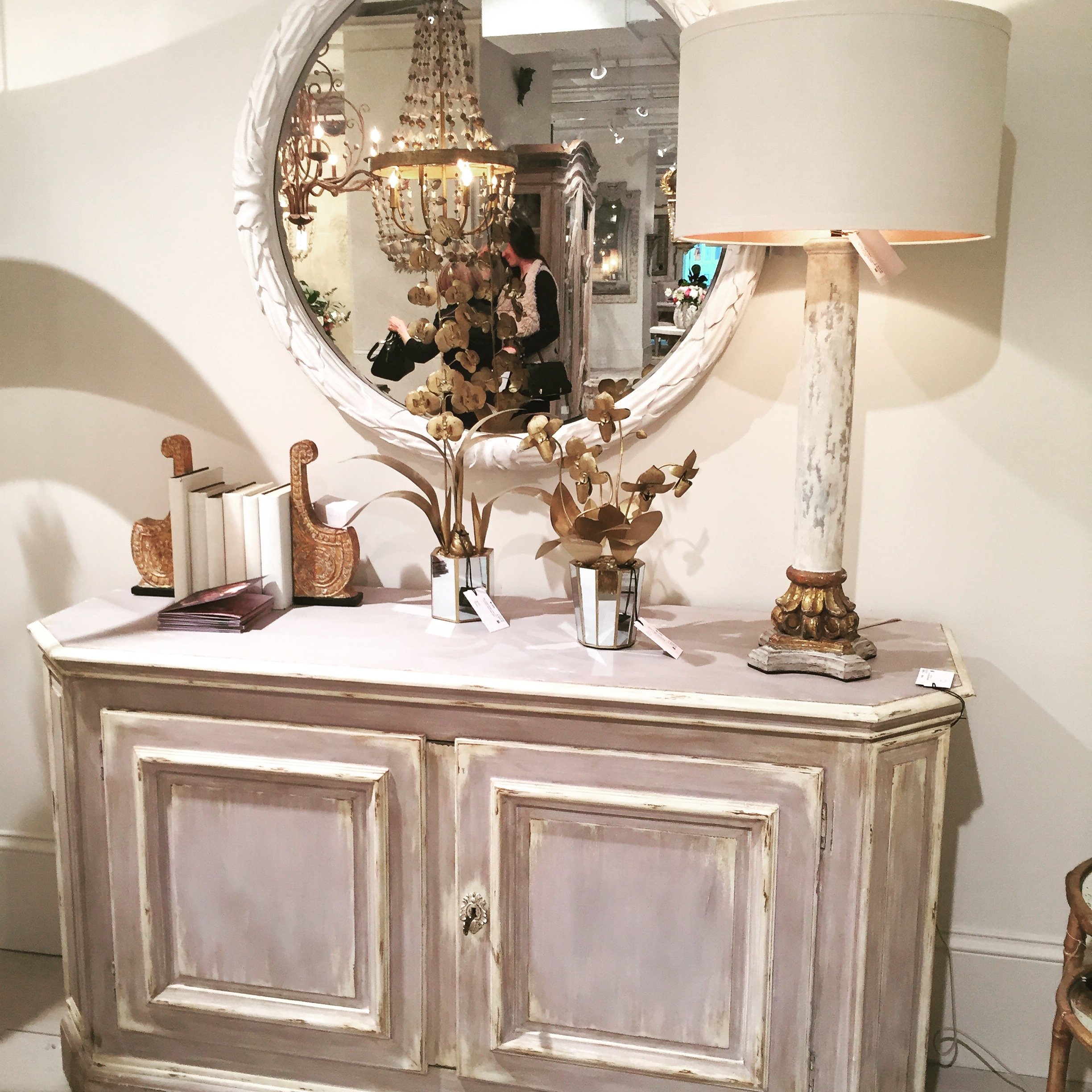 From the Scandinavian patina on the chest to the French chandelier reflected in the mirror, I love everything in this vignette- mixed metals, old and new connected by color, patina and lines.