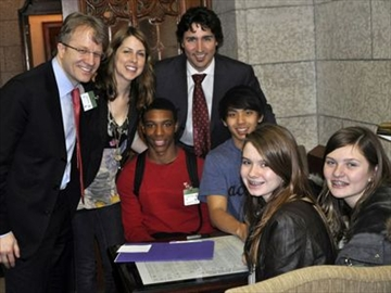 Seated: Jamar Burnette (red sweater), Allan Tran, Emma Lewis (front left) and Joelle Dell'Erede with Parkdale-High Park Liberal MP Gerard Kennedy, left, teacher Alison Mann, and Papineau Liberal MP Justin Trudeau. The students where in Ottawa on International Anti-Discrimination Day on March 21, and decided to bring a message about the challenges Roma students face in Parkdale.
