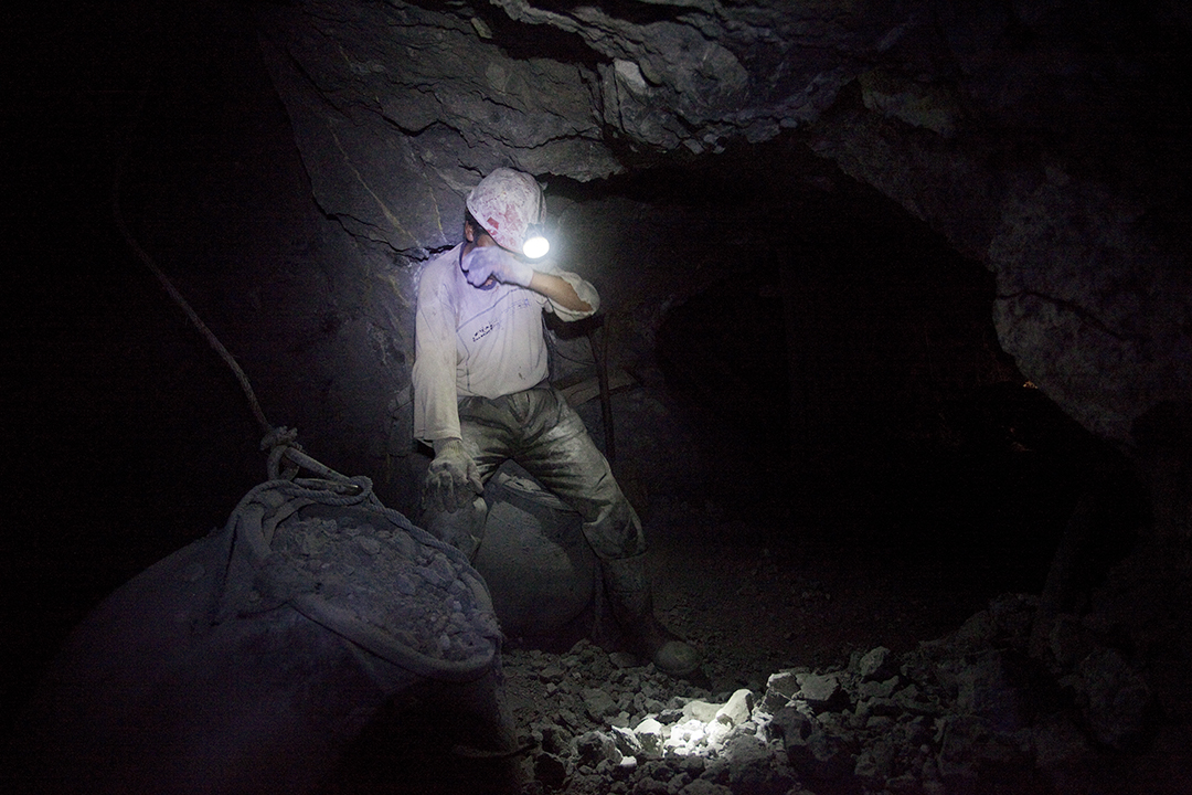 Mineral inside the mine is transported from level to level usinglarge rubber bags and a pulley, often manually operated.