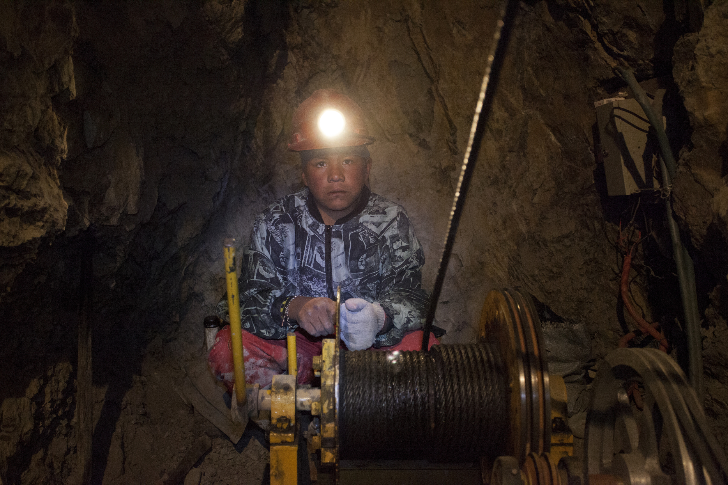 A young boy on his first day working in the mine.