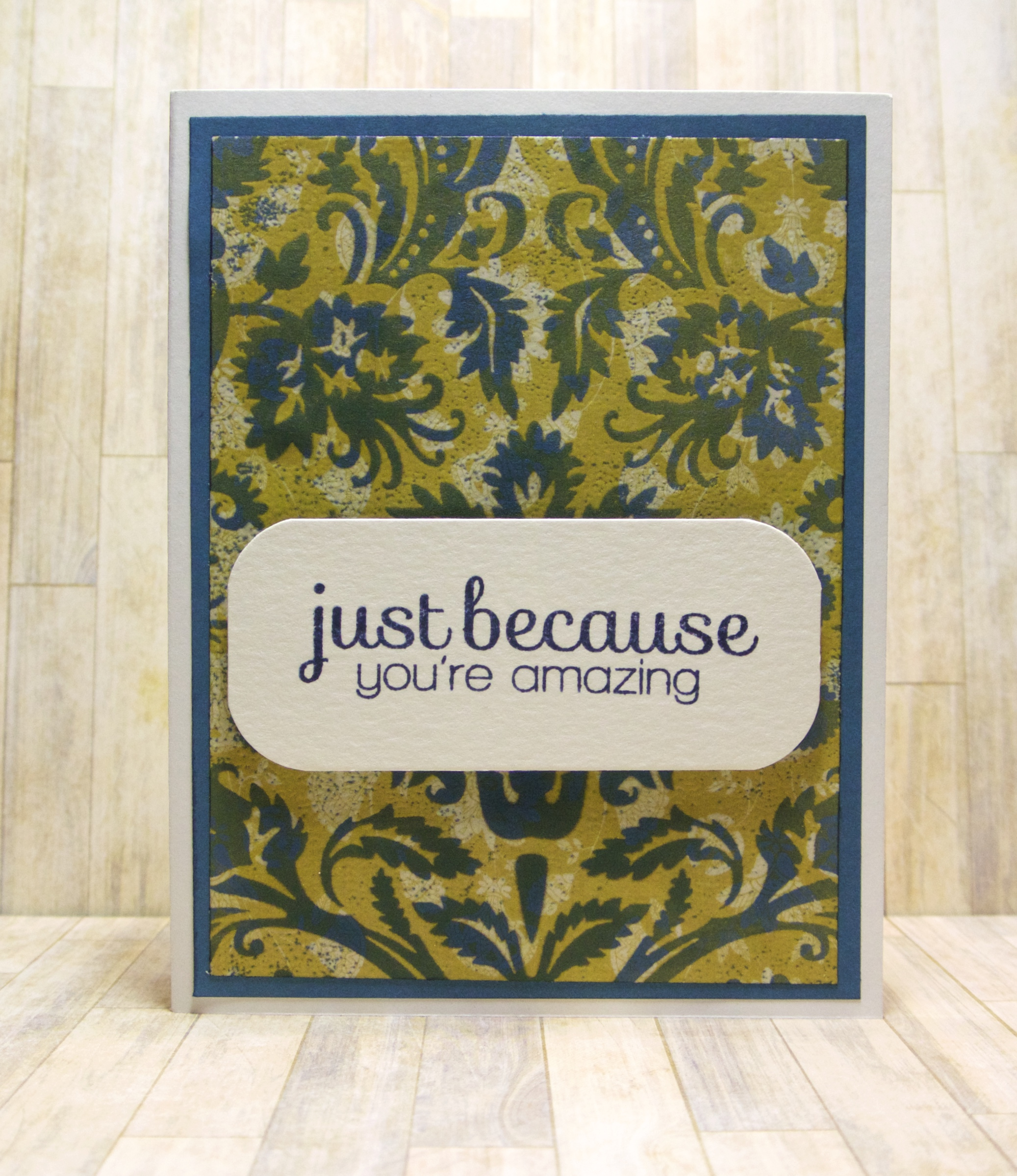 Hero Arts Large Floral cling background, unknown patterned paper, Hero Arts Navy Mid-tone ink, Navy yardstick (unknown), Nenah Solar White cradles, Simon Says Stamp sentiment.