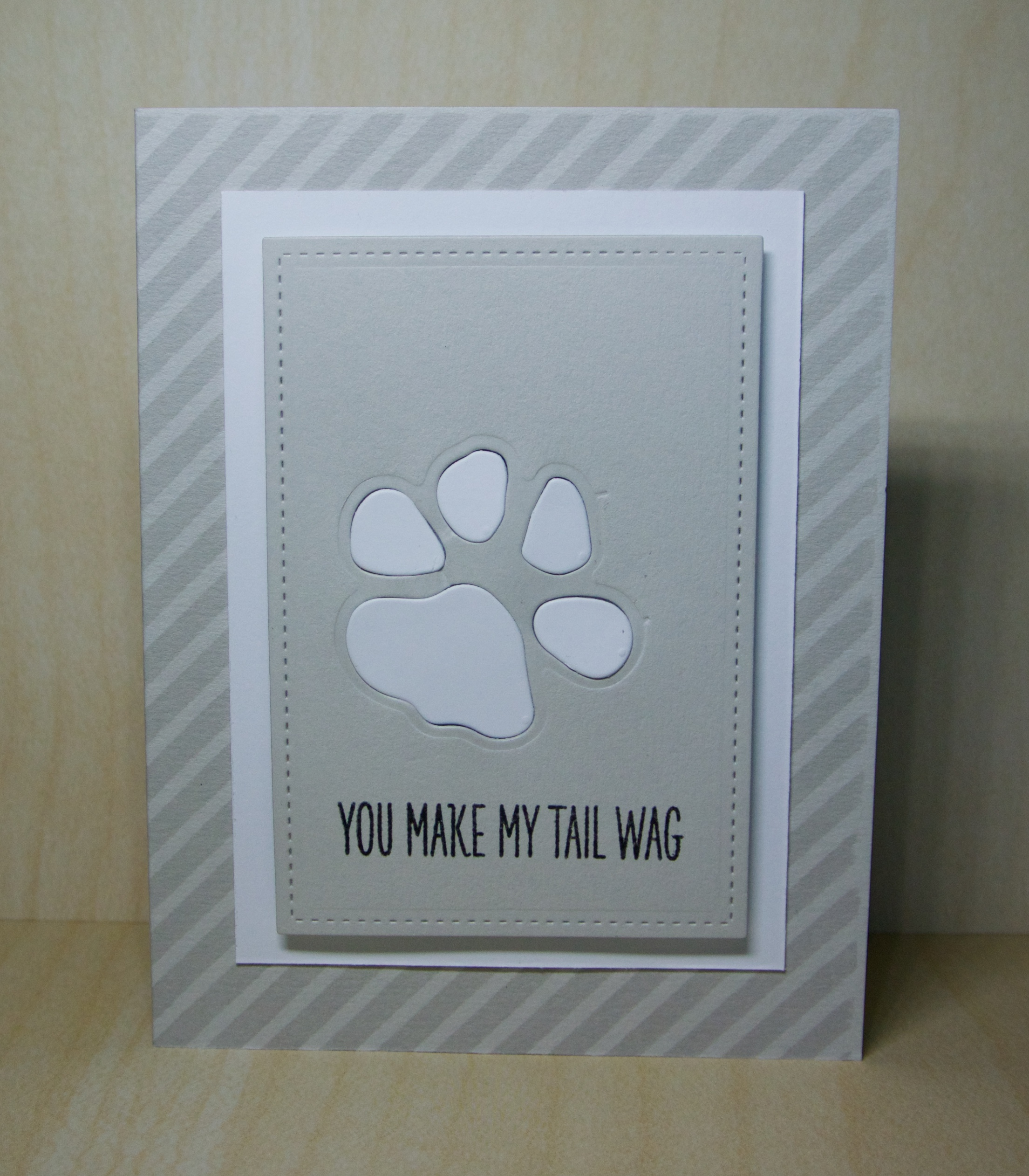 Simon Says Stamp Paw die cut, white inlaid in fog. My Favorite Things sentiment.