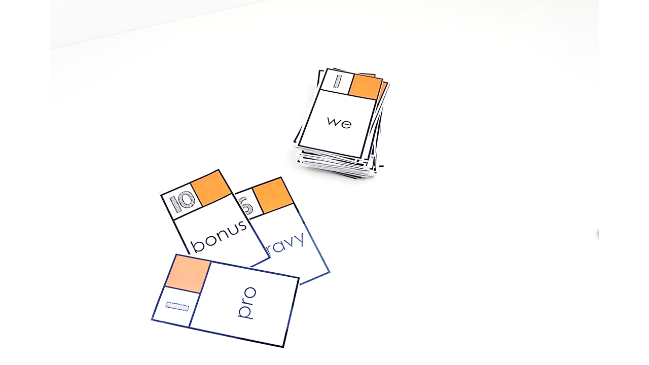You simply split a deck of word cards with point values assigned equally between all players. Each player is required to read their word (you can also have them define their word, use their word in a sentence, give an antonym of the word to create even more instructional goodness out of this one) and then after everyone has read their word (and completed their activity) the person with the highest point value wins all the cards. If the players with the highest point value have a tie, a War will ensue in which each player places three cards face down and then flips the next card. The player with the highest point value on that card is the winner of all the cards.