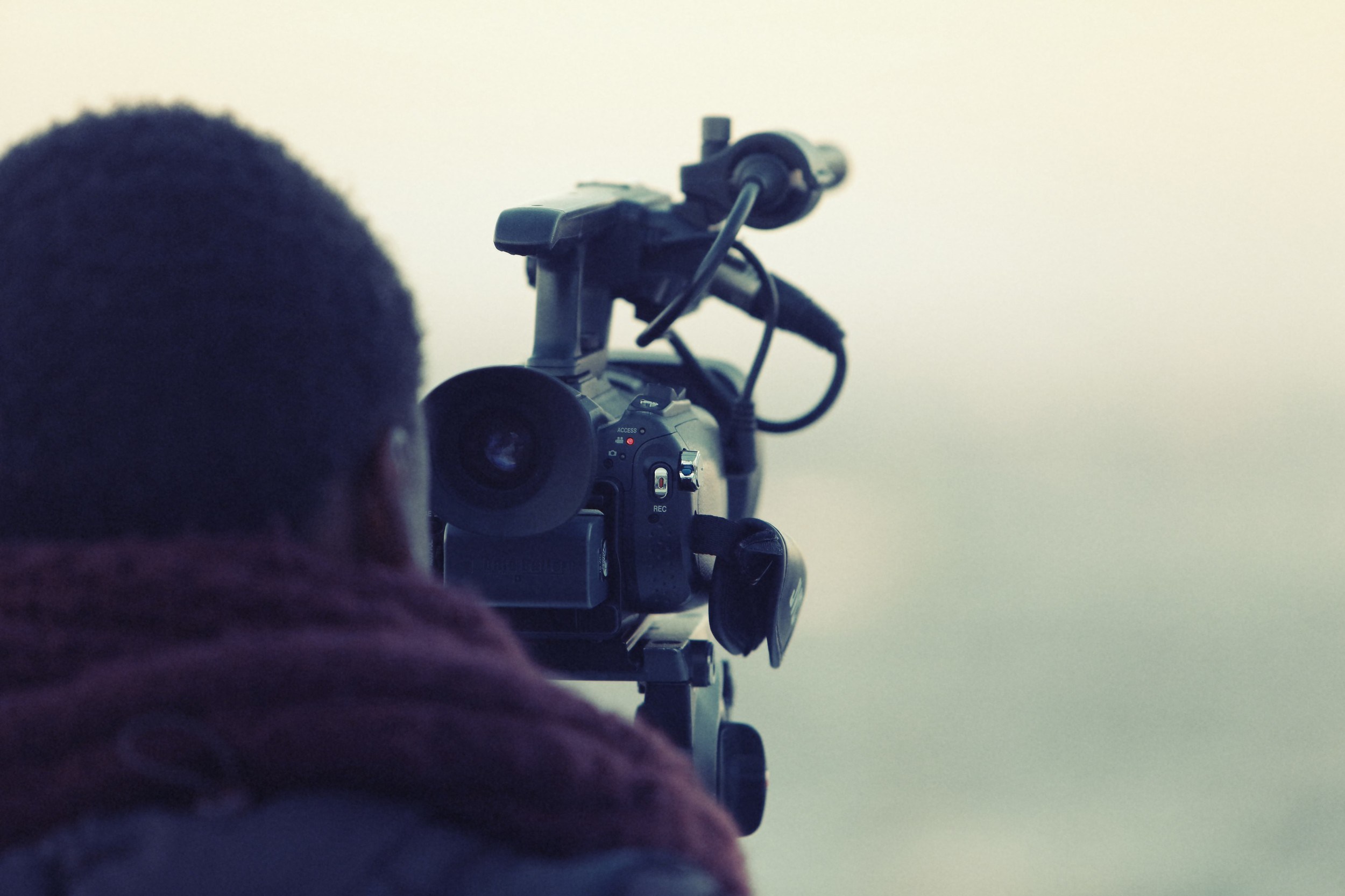 Man with a Video Camera Shooting a Video