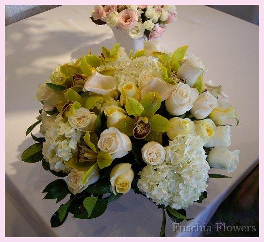 White hydrangea, vendella and crem de la creme roses with mini white callas.jpg