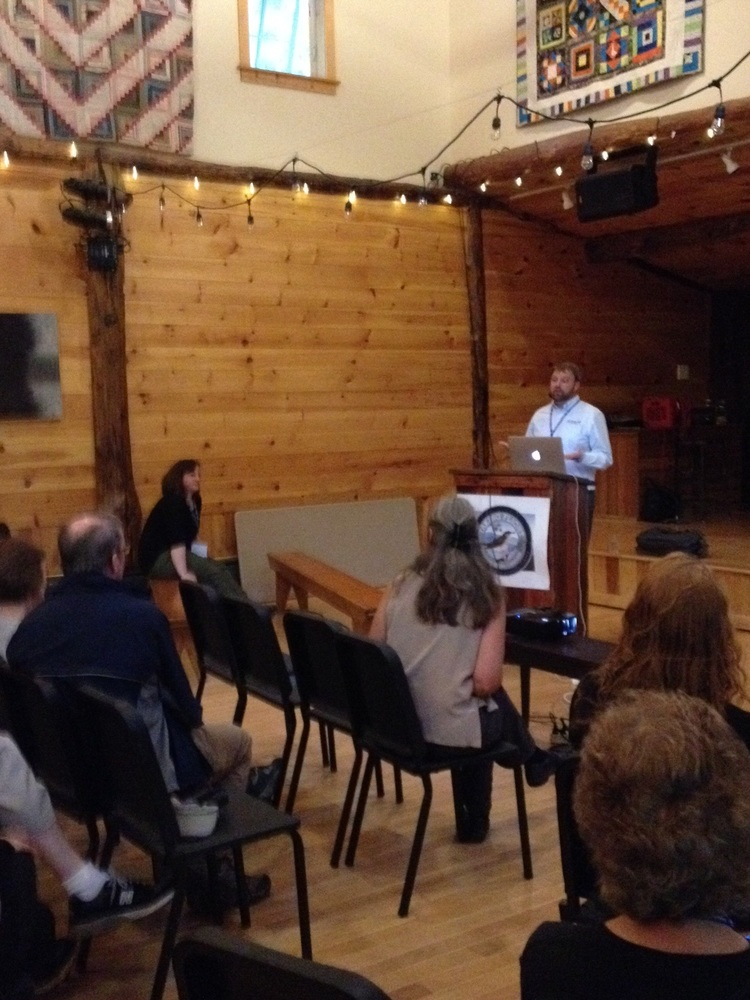 Speakers Chris Wood and Jesse Berry giving a talk about eBird.