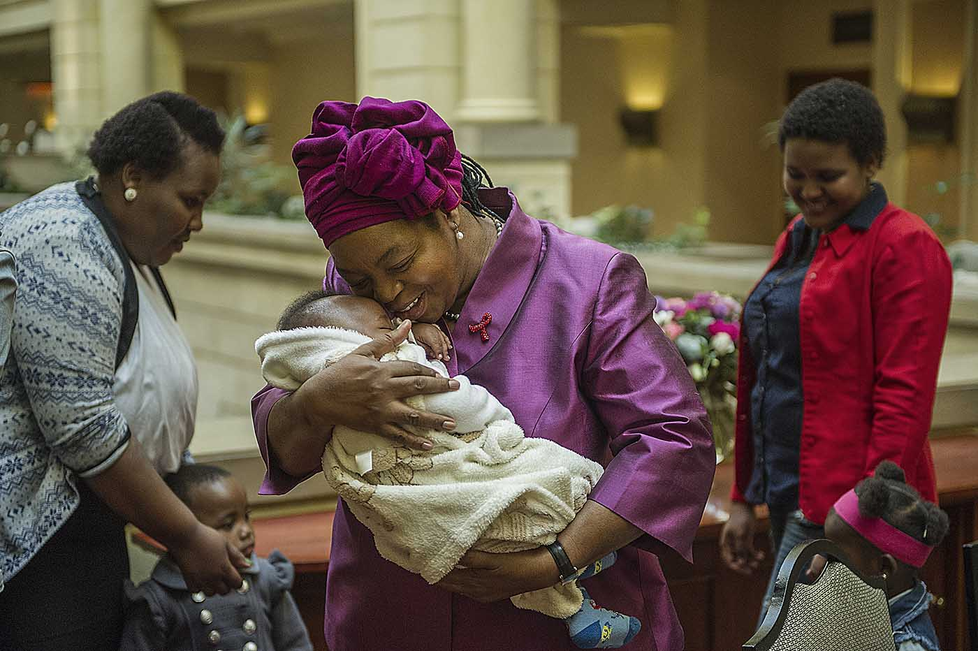 UNAIDS Regional Director for Southern and Eastern Africa, Sheila Tlou, cuddles a baby born free of HIV.