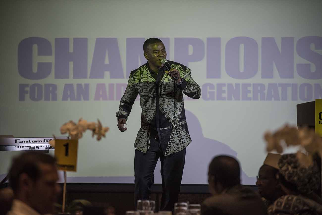 UNAIDS National Goodwill Ambassador, Loyiso Bala, performs at the Champions Gala Dinner.