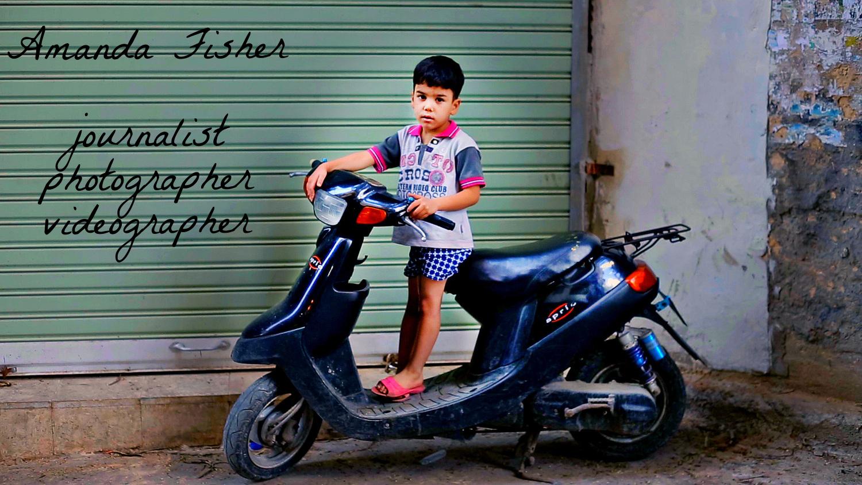 Shatila - kid motorbike.jpg